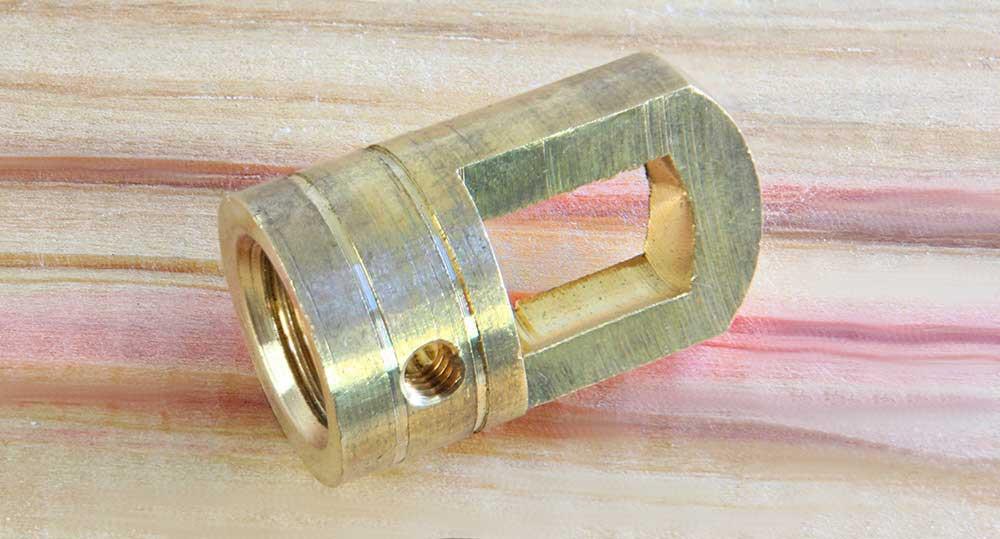Anneau de suspension laiton usiné dans la masse taraudage M12 finition brute annelée
